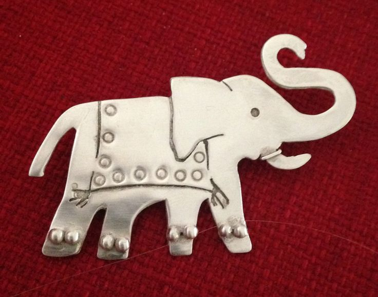 Silver elephant brooch made from silver sheet.