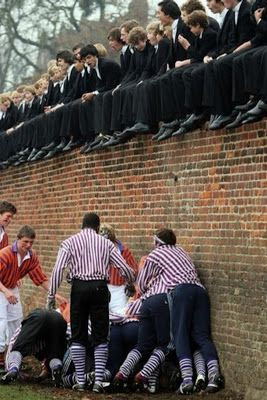 """Eton College students at the annual """"Wall Game,"""" akin to a perpetual rugby scrum; the first recorded game was played in 1766."""