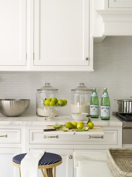 Brick tile backsplash marble pull out cutting board for Are white kitchen cabinets out of style