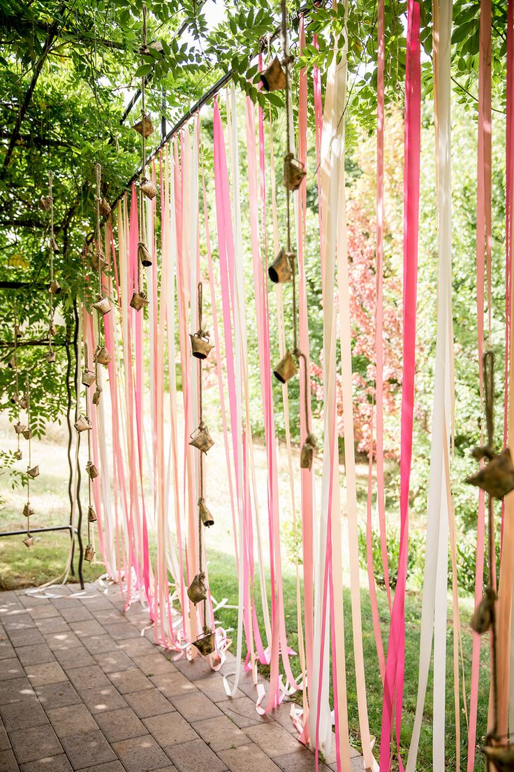 Pink Ribbon Backdrop Wall + Cow Bells ;) Whimsical + Pretty all at the same time! See more here: http://www.StyleMePretty.com/2014/05/13/elegant-oregon-wine-country-wedding/ #SMP - Photography: AlturaStudio.com