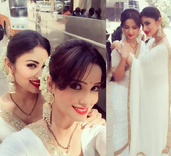 Television's pretty Naagins,Adaa Khan and Mouni Roy recently went for an eye-catching look to shoot a turning point in their show Naagin.    Adaa s...