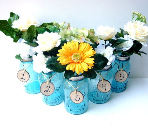These are definitely not your ordinary Party Table Numbers! These Lovely Blue Antique Ball Mason Jars are topped with our handmade flower frog lids that twists on the jar and then adorned with rustic white oak tags. They are fully customizable and we can make as many as you need!    Fill these beautiful jars with water and insert your favorite flowers in between the wire divisions and have a beautiful and aromatic centerpiece for any occasion! The lids make it so your flowers stay in place and ...Blue Mason Jars, Crafts Ideas, Centerpieces Tables, Mason Jars Centerpieces, Tables Numbers, Table Numbers, Antiques Blue, Flower Frogs, Baby Shower