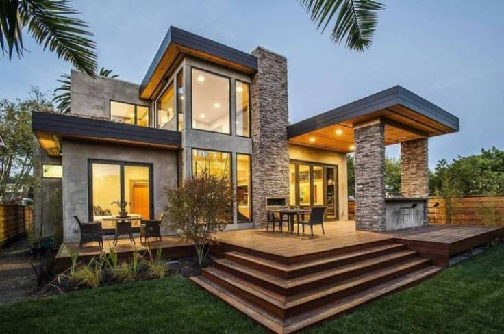 Natural Stone and Stucco Siding on a Modern House Stone, wood porch ceiling, wood deck, black windows and eaves