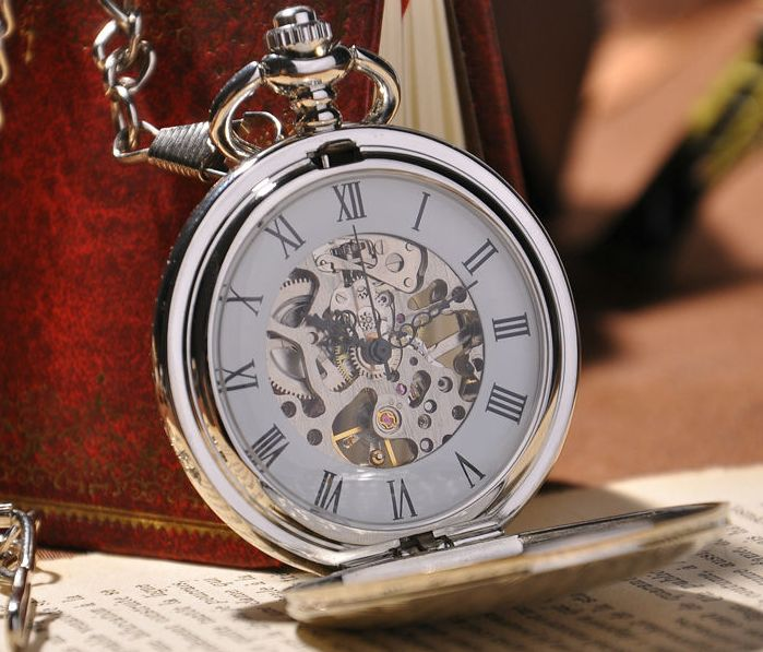 A pocket watch is a must own for every gentleman. This silver pocket watch is an exquisite time piece. See through back panel. Long silver chain. Excellent stainless steel case with designs. Free ship