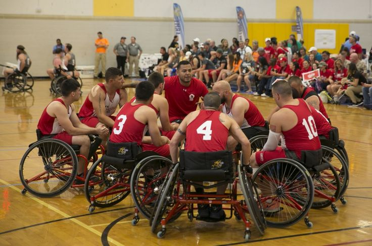 2016 DoD Warrior Games Wheelchair Basketball Game    Members of Team Marine Corps gather for a pre-game huddle.