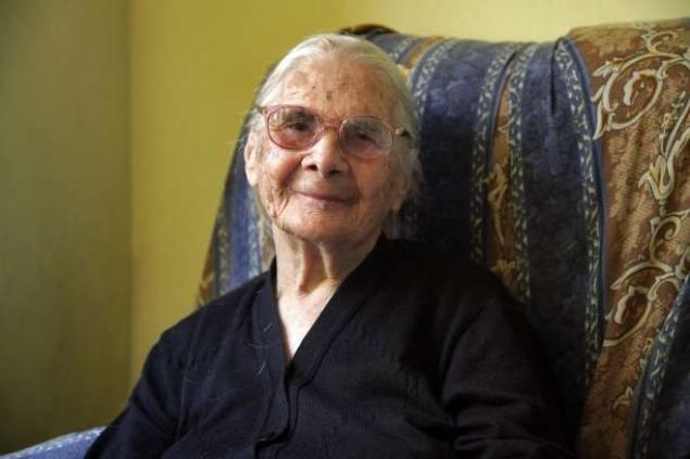 """Consolata Melis, who recently turned 105, Wednesday, poses in her house in the village of Perdasdefogu on the island of Sardinia.  """"In my day women had to cope with household chores, go to the source to get water, to the river to wash clothes. My grandchildren have washing machines, dishwasher and a vacuum cleaner. And when I hear these new words 'we are stressed,' I do not understand."""""""