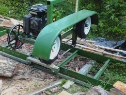 Bandsaw Mill - Homemade bandsaw mill featuring a 20' long track. Powered by a 10 HP motor and equipped with a 1-1/4