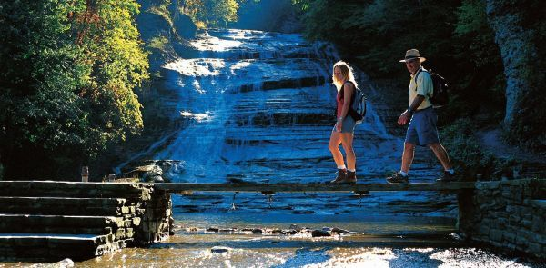 For the best way to combine land and water, head over to the Ithaca region. The Finger Lakes are famous for, well, a handful of large, beautiful lakes, but the area's waterfalls are just as worthy of a road trip. Some are so stunning you have to wonder why they aren't international attractions. But then this relative obscurity also means you can easily find yourself alone on a shady path, the only noise around that of water ricocheting off stone formations. Many of the area's waterfalls are…