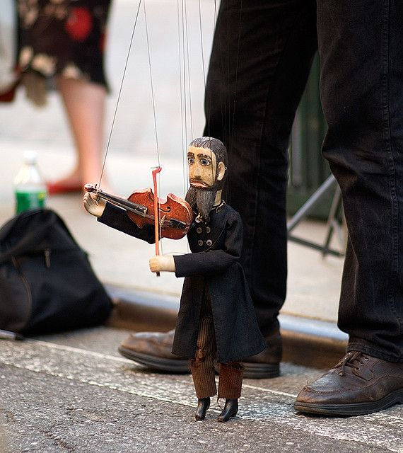 A marionette of a violinist performs at the 27th Annual Museum Mile Festival, NYC