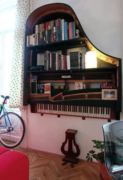 A damaged grand piano destined for the dump but instead turned into a gorgeous bookcase.