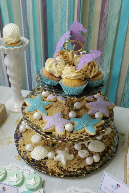 "Cookies on edible ""sand"" at a Under the Sea Mermaid Party #underthesea #mermaidpartycookies"