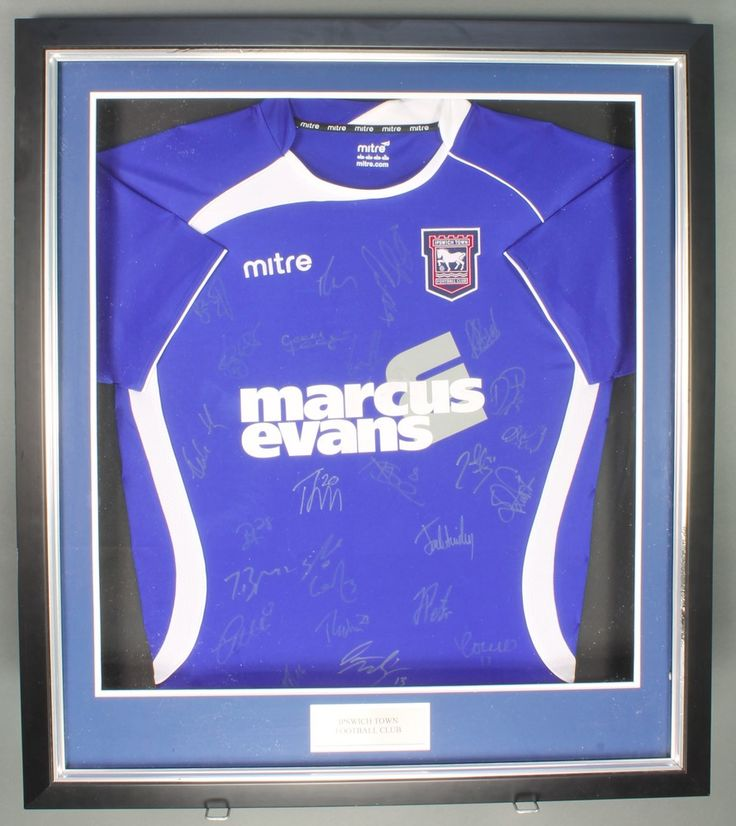 Lot 363, An Ipswich Town Football Club 2011 home football shirt, framed, with numerous players signatures, purchased at a Lord's Taverners Bobby Robson memorial charity lunch 13 May 2011, together with a ticket for the event est £30-50