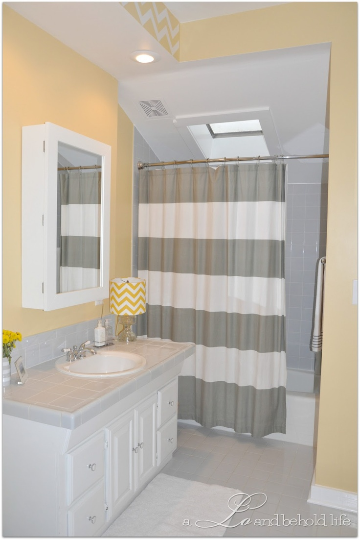 A lo and behold life our home tour chevron on the for Yellow grey bathroom decor