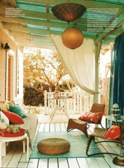 This summer has already been a SIZZLER and we'll do just about anything to keep cool..so our Room of the Week this week is a fabulous porch. Half shaded, half exposed there is room to relax, dine or entertain. Plus the lighting, rugs and accent pillows make it cozy and fun. We're pretty sure we would live out here if this was our porch!