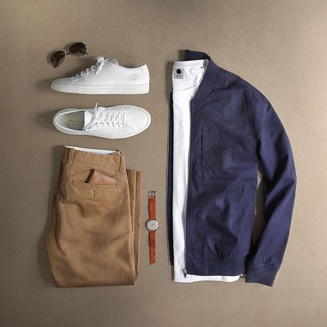 Transitional palettes and my favorite sneaks.  Shoes: @commonprojects Achilles Low T-Shirt: @nonationality07 Pima Cotton Jacket: @topman Chinos: @jcrewmens 484 Essential Chino Watch: @miansai M12 Sunglasses: @rayban Aviator Wallet: @bisonmade