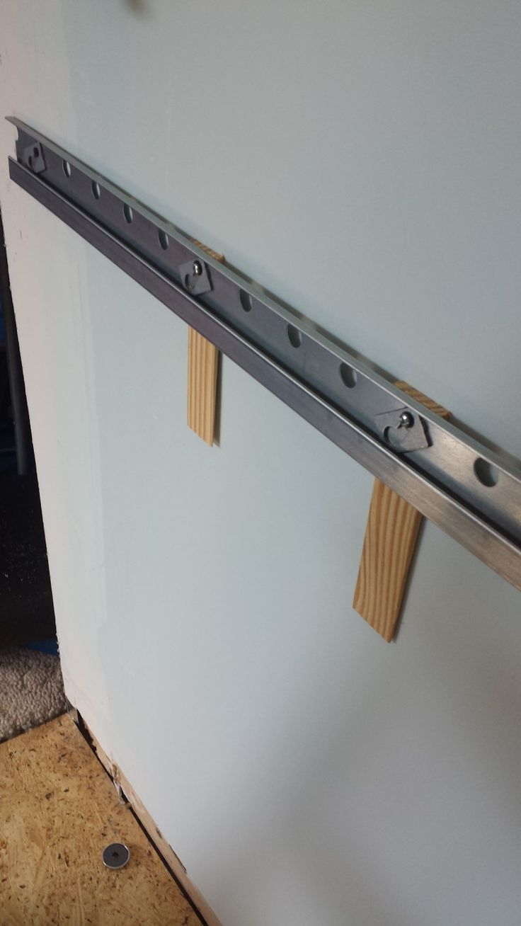 Shims behind the rail in my not-even-a-little-bit flat wall