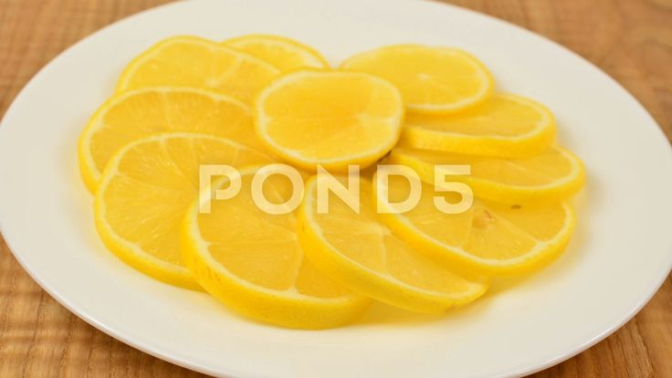 Shooting of a lemon. Stop motion. #lemon #plate #cut #board #citrus #cutting #dish #food #fresh #fruit #juicy #light #natural #organic #raw #ripe #side #sliced #slices #tropical #white #wood #yellow #acid #background #bowl #bright #brightly #closeup #diet #freshness #half #health #healthy #ingredient #juice #nature #nutrition #peel #section #slice #sour #space #table #taste #vegetarian #vitamin #wooden #color