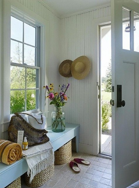 Beach house entryway with custom storage bench, baskets and a country cottage feel.