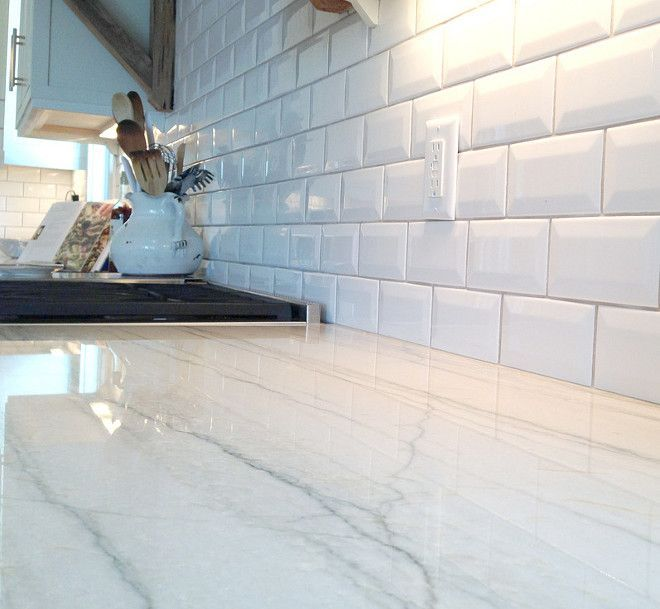 The kitchen counter tops are White Macaubus Quartzite. It is a beautiful surface that has the appearance of marble but has a much harder and more durable quality than granite, which means it won't scratch and stain like a marble counter will.