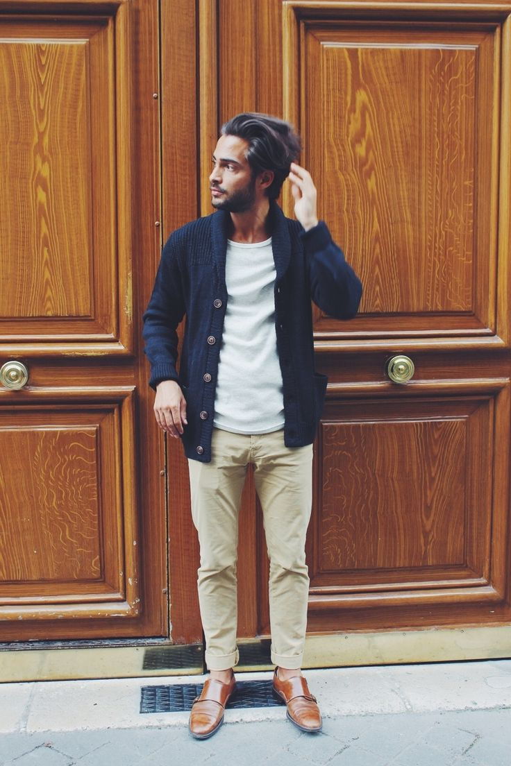 Go for a dark blue shawl cardigan and beige chinos to look classy but not particularly formal. Smarten up your outfit with brown leather double monks.   Shop this look on Lookastic: https://lookastic.com/men/looks/navy-shawl-cardigan-white-crew-neck-t-shirt-beige-chinos/14562   — White Crew-neck T-shirt  — Navy Shawl Cardigan  — Beige Chinos  — Brown Leather Double Monks