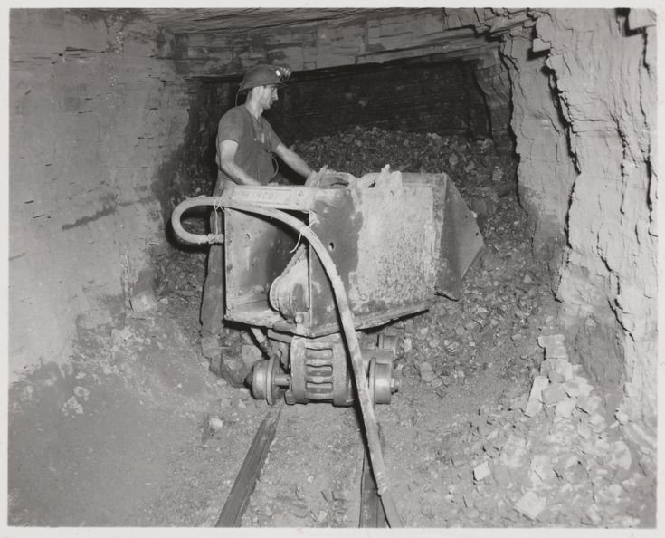 816B/TB/2687: Miner operating a mechanical bogger, scooping up asbestos ore, Wittenoom, July 1958 http://encore.slwa.wa.gov.au/iii/encore/record/C__Rb1882611?lang=eng