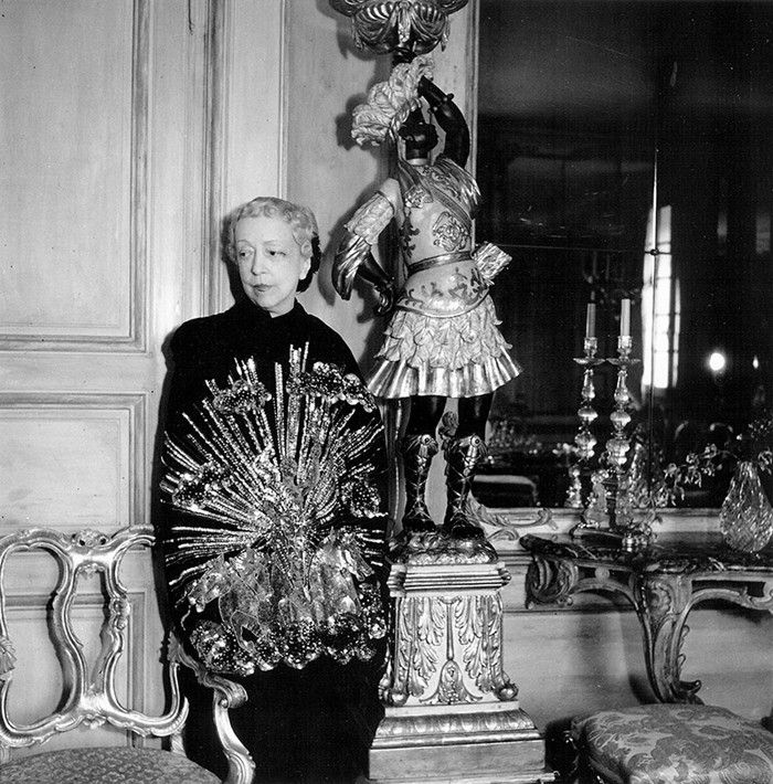 """""""Be pretty if you can, be witty if you must, but be gracious if it kills you"""" — Elise De Wolfe. Elise pictured in her Paris apartment wearing a Schiaparelli cape, late 1930s Photography by Cecil Beaton; Courtesy of R. Louis Bofferding"""
