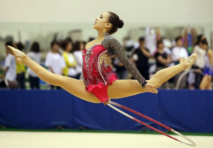 South Korean rhythmic gymnast Son Yeon-jae performs with a hoop during a competition to select members of the national team for the world championships and the Asian Games, at the Taeneung Athletes' Village in northern Seoul, South Korea