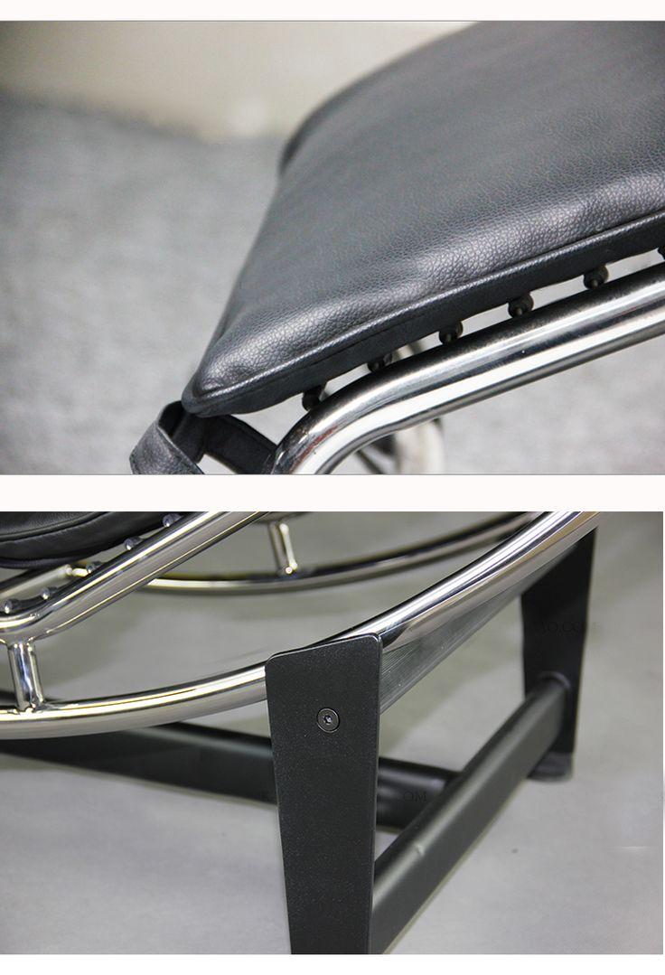 Металлический каркас и черная кожаная обивка кресла