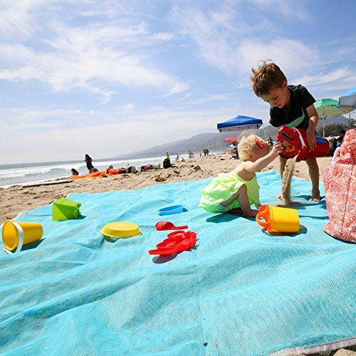 Magic Sand Free Large Family Beach Blanket Mat - Perfect For Baby, Toddler & Kids - Best Portable Sandless Folding Beach Throw / Cover. 100% Sand-free kid friendly. For product & price info go to:  https://all4hiking.com/products/magic-sand-free-large-family-beach-blanket-mat-perfect-for-baby-toddler-kids-best-portable-sandless-folding-beach-throw-cover-100-sand-free-kid-friendly/