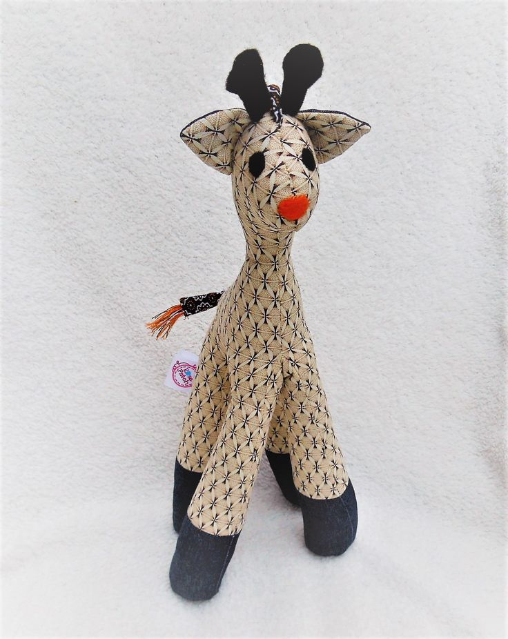 Giraffe created in tshwe-tshwe print which is 100% cotton fabric made in South Africa.