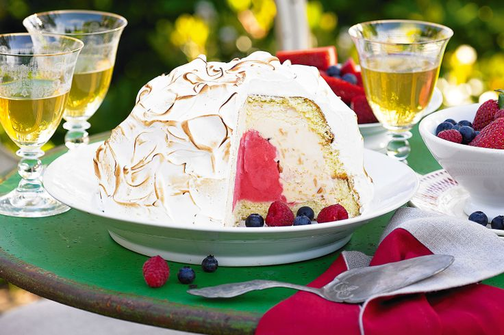 Enchant guests with this magnificent meringue-encased sponge cake, delicately filled with sorbet and ice-cream.