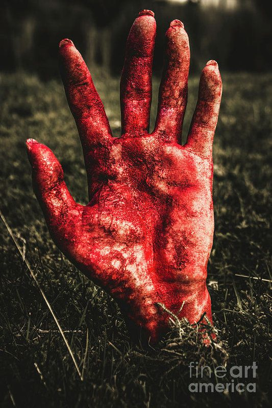 Frightening picture of woman's blood stained hand pushing up cemetery dirt at graveyard. Fright night terror by Jorgo Photography - Wall Art Gallery