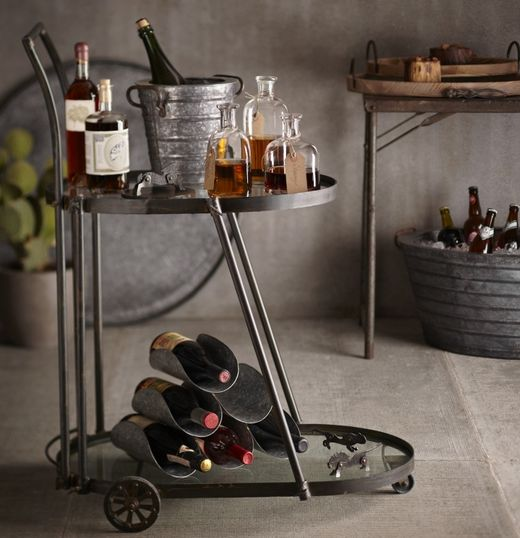 It's not hard to imagine pushing this gorgeous cart around at a party, right? | 19 Ways An Industrial Bar Cart Can Improve Your Life