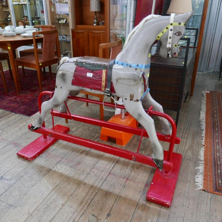 Perfect for your child's nursery, this vintage timber rocking horse on stand with stirrups is a unique piece of furniture. Circa 1930's