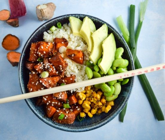 Teriyaki Cauliflower Rice Bowls Recipe with cauliflower, garlic, ginger root, coconut milk, rice, sweet potatoes, edamame, corn kernels, avocado, green onions, sesame seeds, teriyaki sauce