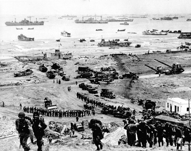 The Normandy Invasion: The Story in Pictures  The build-up of Omaha Beach. Reinforcements of men and equipment moving inland. SC193082