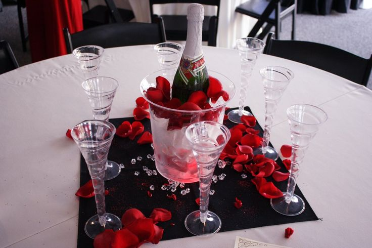 Lighted champagne centerpieces glow in the dim light. Perfect for weddings or New Year's Eve.