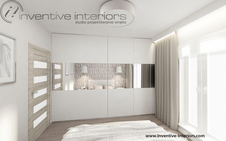 Projekt sypialni Inventive Interiors - biała szafa w beżowej przytulnej sypialni