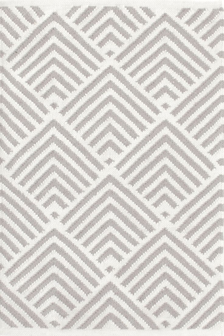 A traditional kilim weave gets the indoor/outdoor treatment in eco-friendly recycled materials and a woof-worthy graphic pattern in classic ivory and a single gorgeous color. Variations in color are expected.