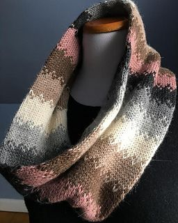 The Hawthrone Street Cowl is a reversible accessory featuring stripes of solid color separated with three simple rows of colorwork. The colorwork section assists in the transition from one color to the next. Striped section widths decrease around the cowl adding subtle visual variation.