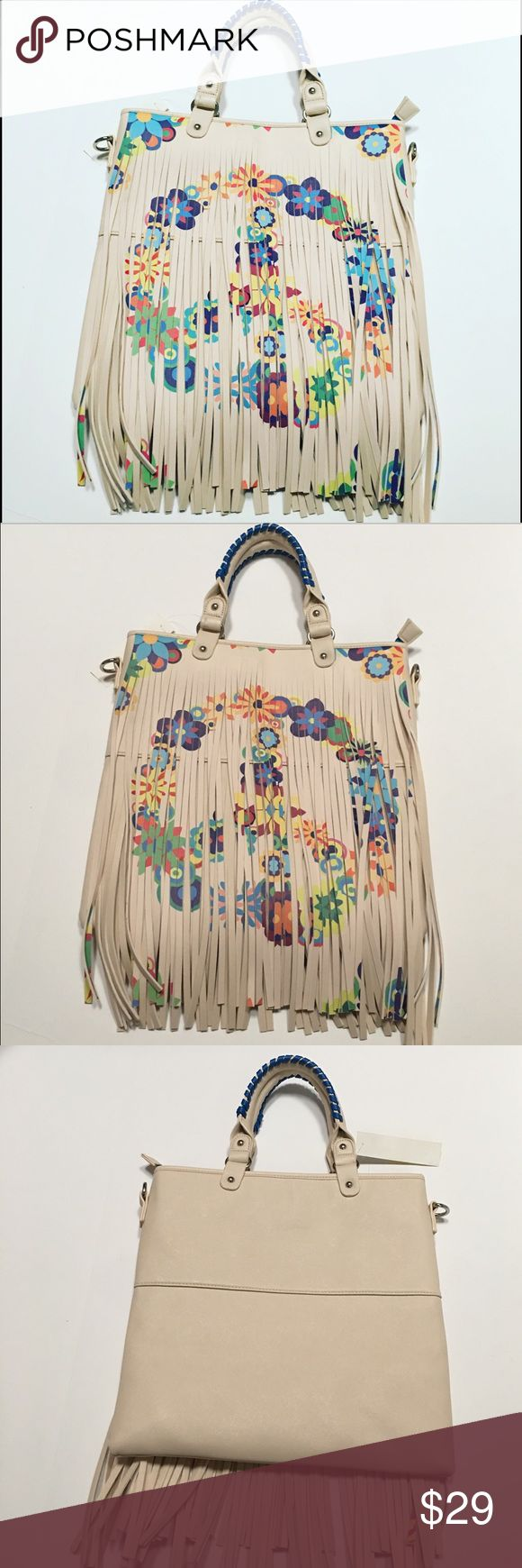 🆕Fringe Peace Sign Large Crossbody Bag Very spring like and just a gorgeous bag. The measurements are 14 1/2 inches width and 13 1/2 inches length. The shoulder straps can be removed if you just want to use the handles or it makes a very cute Crossbody bag. You can see the size in the last picture I took with the bag. Bags Crossbody Bags