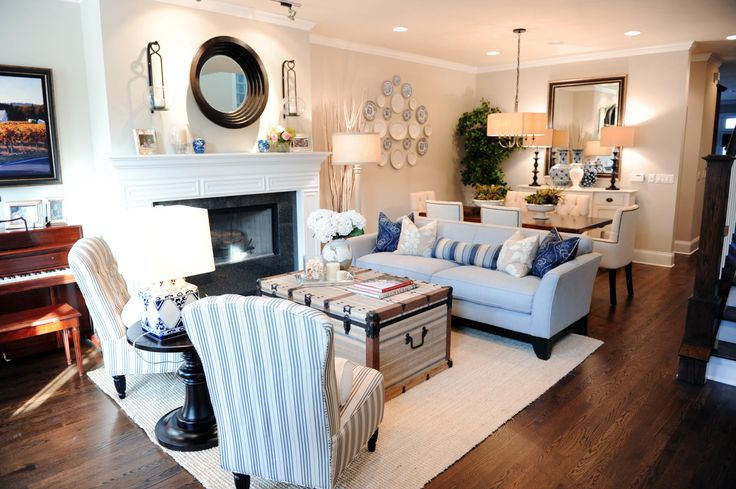 Super cute Nautical living room, dining room combo. I love the old chest as a coffee table.
