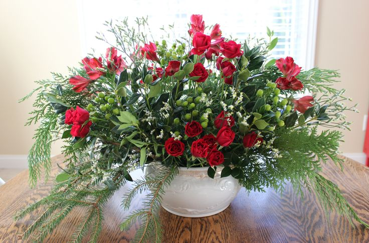 Floral Arrangements Evansville In : Winter arrangement created with red spray roses and