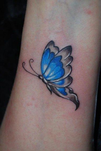 Little blue butterfly on wrist