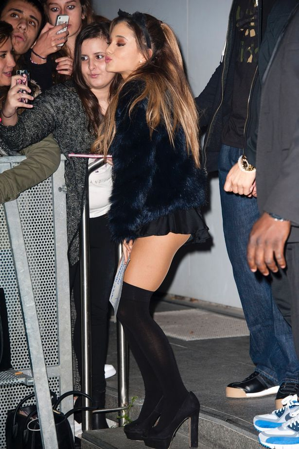 Selfie time: Ariana poses for a snap with fans wearing her super-small miniskirt
