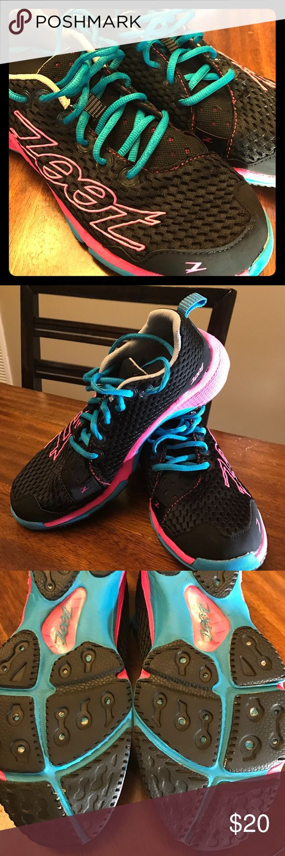 Ladies Running Shoes Black sneakers with hot pink and turquoise blue. The soles do show wear but other than that these sneaks are in great shape. They are made for triathlon runners so they are incredibly breathable. Zoot Shoes Athletic Shoes