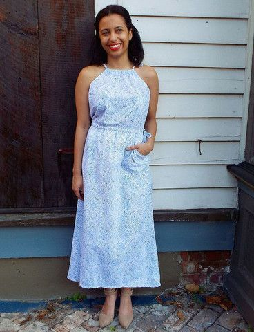 """Blue Maxi Dress - Fully lined and 100% cotton with front pockets! This blue and white maxi dress features a hand block printed design created using eco-friendly dyes. A slip on dress with adjustable ties at the neck and a drawstring waist - a perfect addition to your closet! The model is wearing a S and is 5'3"""" tall. Designed in New Orleans and made in India. Fair Trade."""