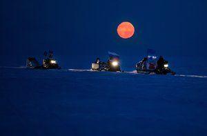Reindeer herders ride snow motorcycles back to Nomad camp