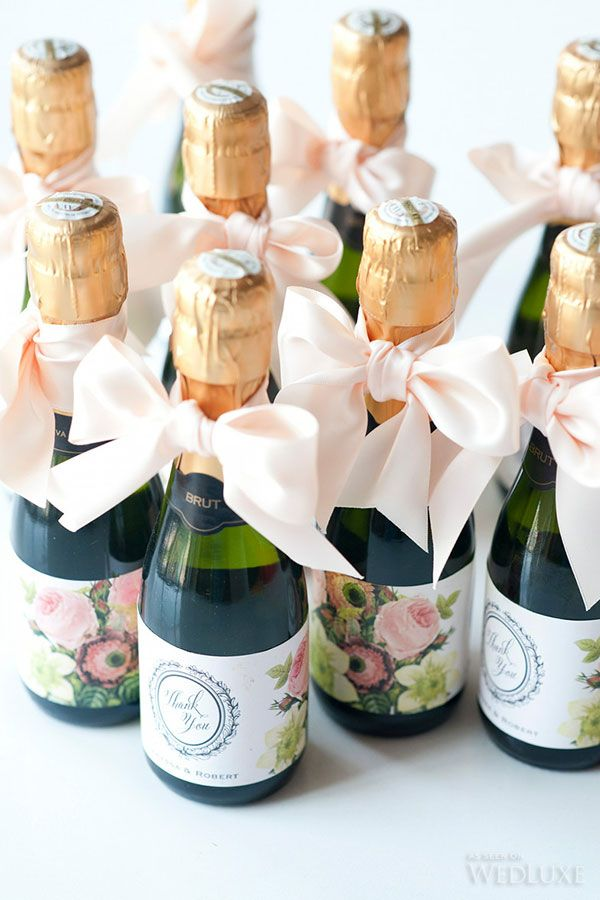 Personalized labels on mini champagne bottles