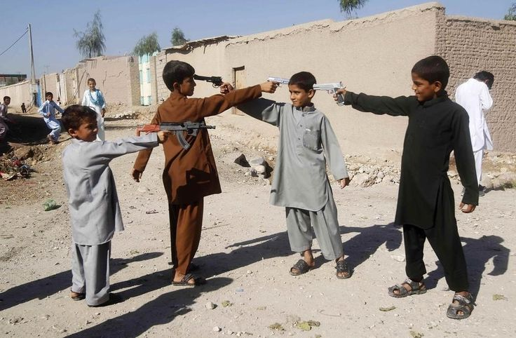 Afghan boys play with toy guns on the first day of Eid al-Adha in October. (Parwiz / Reuters) | The 45 Most Powerful Photos Of 2013